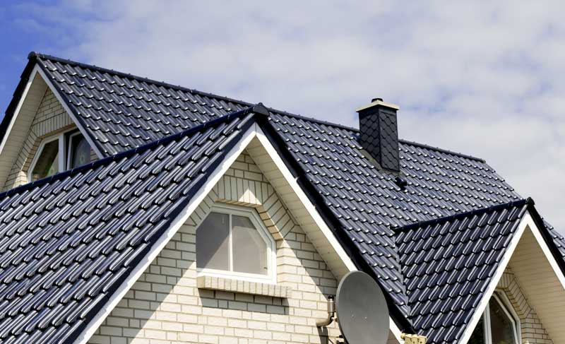beautiful home with tile roofing