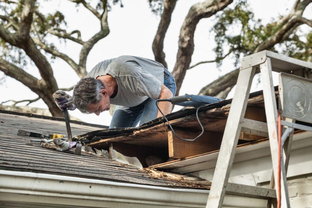 homeowner doing roof maintenance