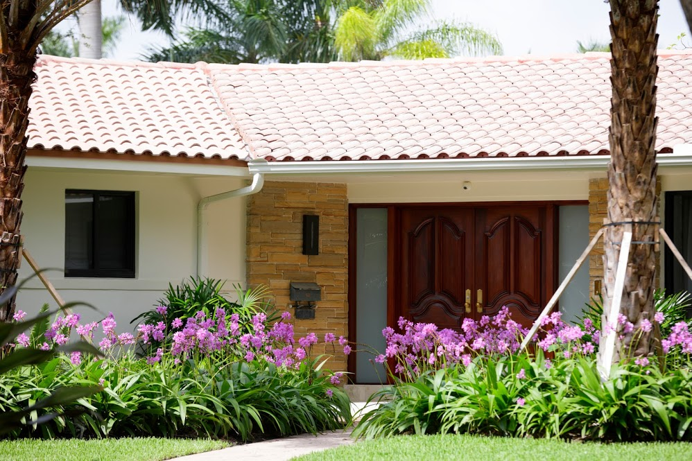 tile residential roof with beautiful gardens