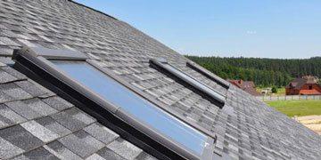 asphalt shingle roof with installed daylighting