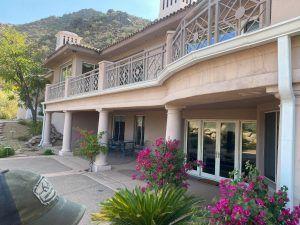A Phoenix walk deck on the side of a beige house.