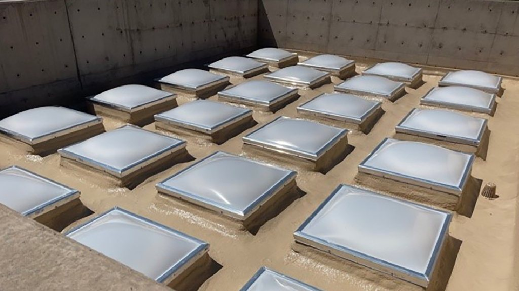A rooftop with a 4x6 grid of opaque skylights.