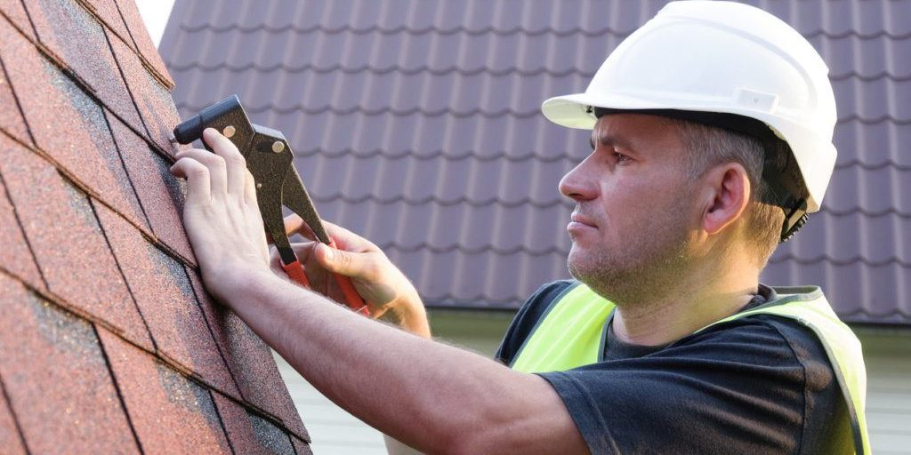 roofing contractor installing shingles