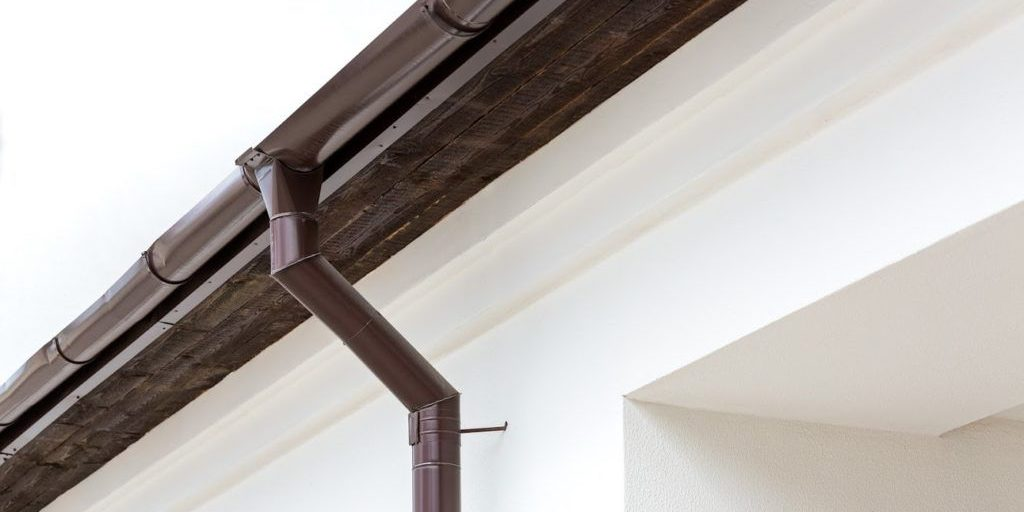 brown guttern and drainpipe