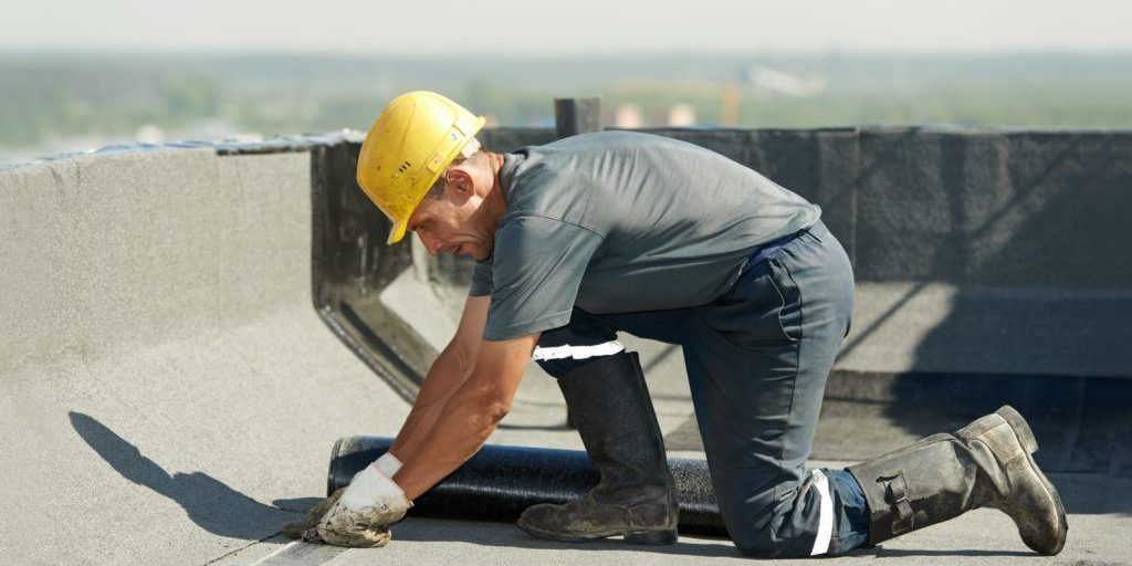 roofing contractor fixing flat roof issue