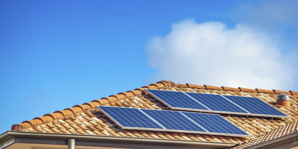 Solar panels on a residential roof. These panels offer both pros and cons.