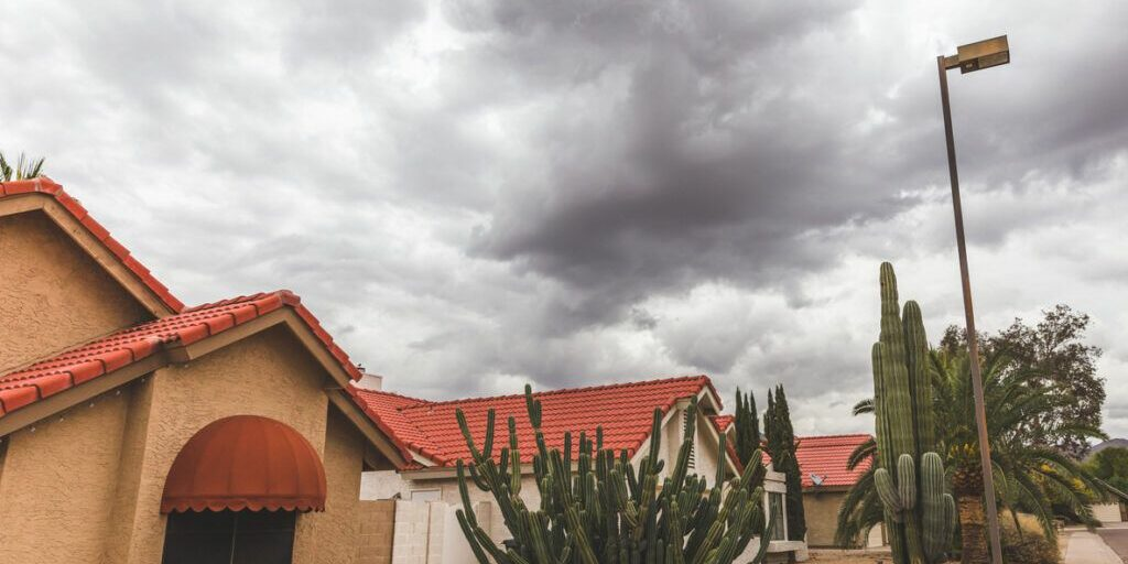 A tiled roof In Arizona with impending storm clouds rolling overhead In Arizona,